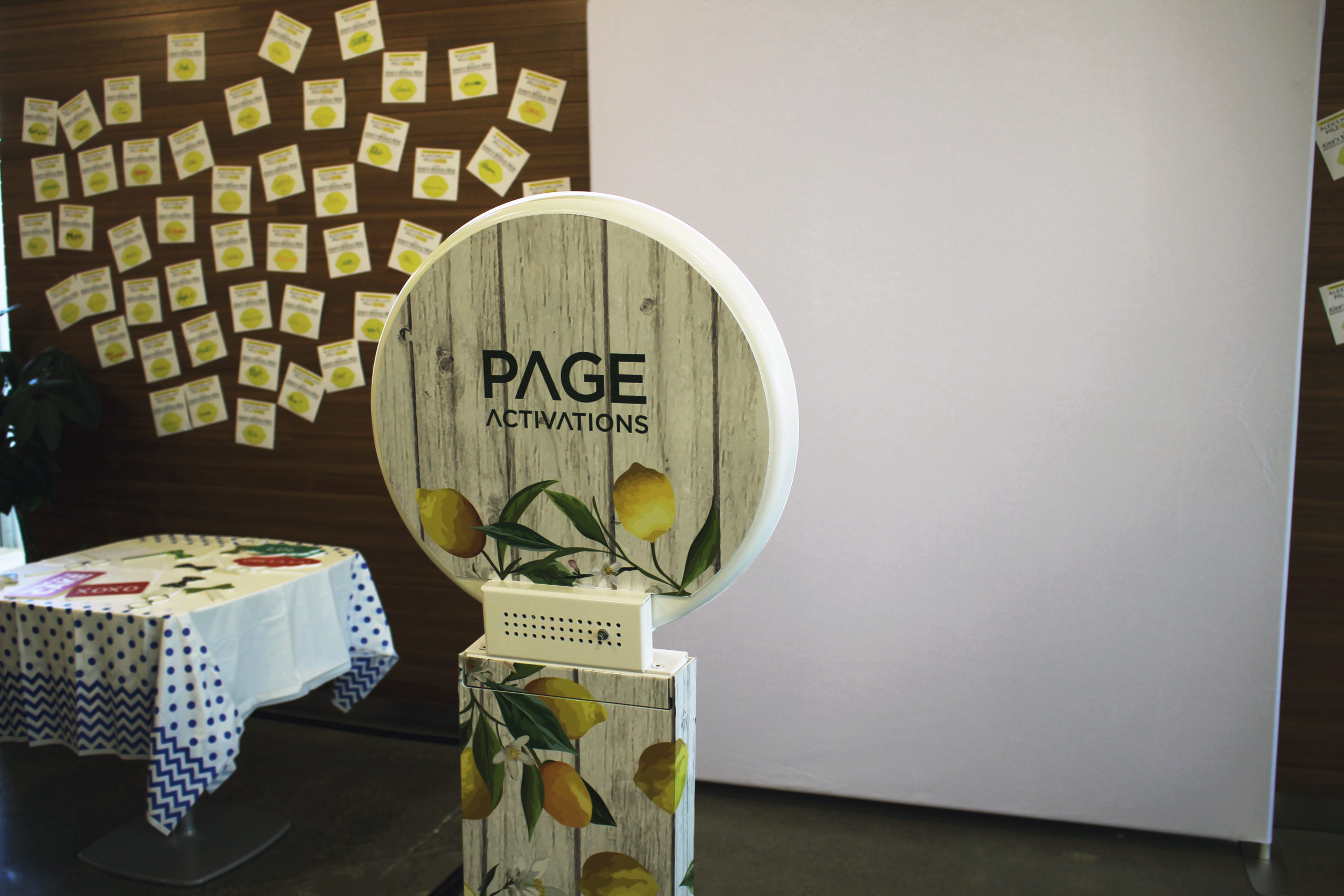 Custom vinyl wrap photobooth with props and white backdrop
